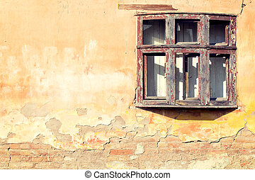 Old window - Old wooden window on the yellow brick wall
