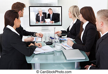 Businesspeople Attending Video Conference - Businesspeople...