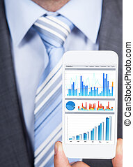 Businessman Showing Graphs On Smartphone - Closeup of...
