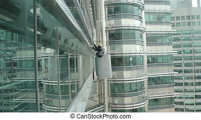 Repairman on a skyscraper