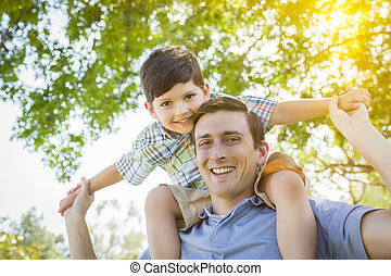 Father and Son Playing Piggyback in the Park