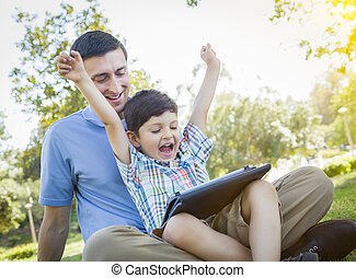 Handsome Mixed Race Father and Son Playing on Computer...
