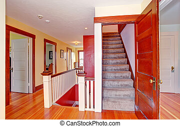 Hallway with open door to upstairs - Hallway with hardwood...
