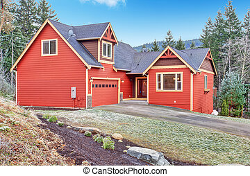 House exterior. View of front side - Red clapboard siding...