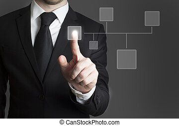 businessman pressing virtual button group - man in black...