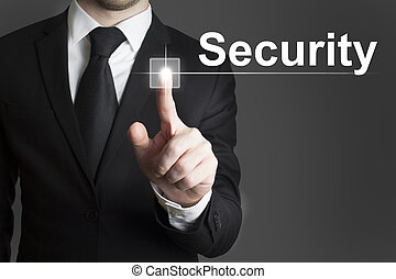 Businessman pressing virtual button security