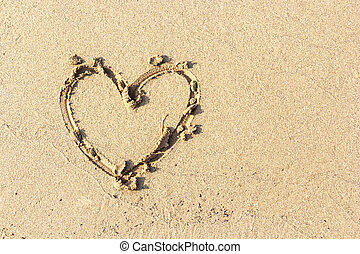 Heart drawn in the sand , sand backgrounds and texture -...