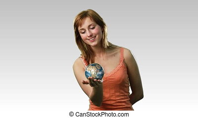 Female with the world in her hands - High Definition footage...