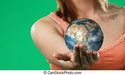 Woman Holding a Globe in her hand - HD footage of an...