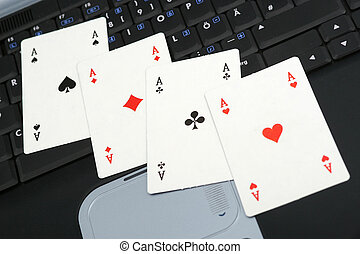 Online gambling - Four Ases on the notebook