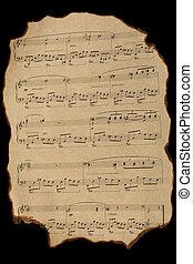 Old burnt notes on vintage paper on black background