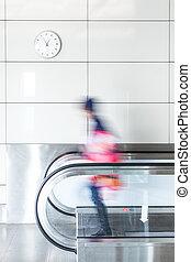 Walking person on walkway - Walking young girl on walkway in...