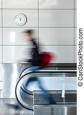 Walking person on walkway - Walking young man on walkway in...