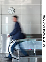 Walking person on walkway - Walking young businessman on...