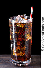 Glass of cola with ice and straw