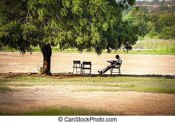 Resting under a tree - Man resting under a tree in West...