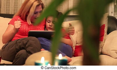 mother and son using digital tablet - dolly shot mother and...