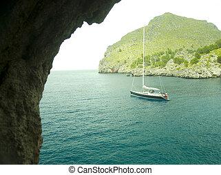 mallorca - sailing boat in a lonley ocean bay in mallorca...