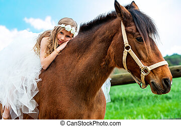 Girl relaxing on horseback - Portrait of cute girl relaxing...