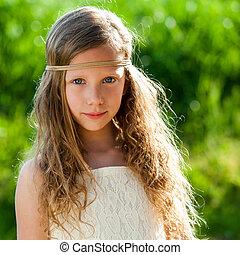 Portrait of cute girl wearing ribbon headband.