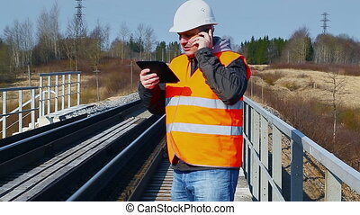 Railroad worker talking on the cell phone