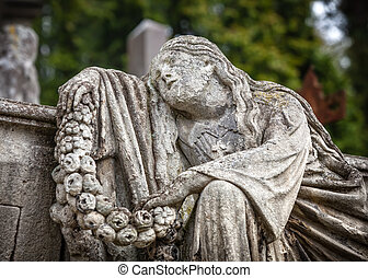 statue on grave in the old cemetery