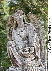 statue on grave in the old cemetery - Old statue on grave in...