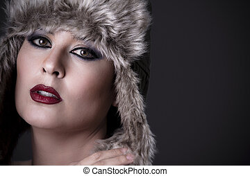 Elegant nude woman with typical Russian fur hat and perfect skin