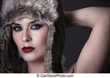 Interesting nude woman with typical Russian fur hat