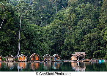 Bungalow on tropical lake - Wooden bungalows on tropical...