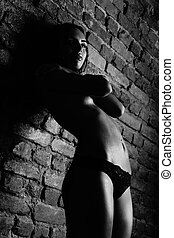 The girl at the wall - The girl in the lower beley a brick...