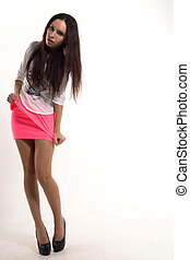 A girl in a pink skirt. - Girl on a white background in a...