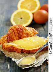Lemon curd on a slice of fresh croissant.