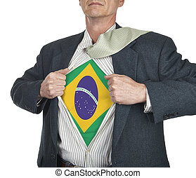 Businessman showing brazil flag superhero suit underneath...