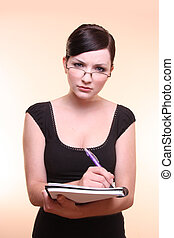 Woman holdling notebook and pen note taking