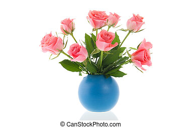 Bouquet pink roses in blue vase isolated over white...
