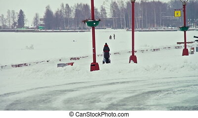 Frozen lake embankment during snowfall - PETROZAVODSK,...