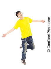 Full length of stylish young man dancing