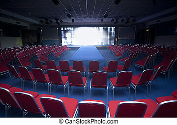 conference room with chairs and big screen