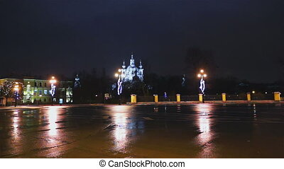 Cars passing by Smolensky Cathedral and Christmas tree...