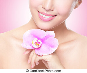 beautiful face with pink orchids - beautiful face of young...