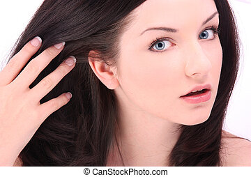Beautiful Brunette Touching Hair On White Background