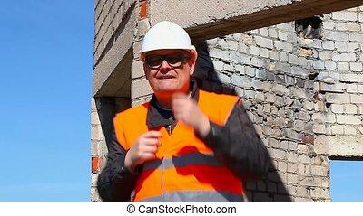Happy worker dancing
