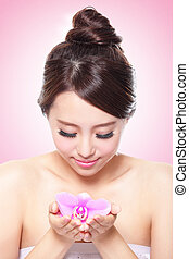 beautiful face with pink orchids
