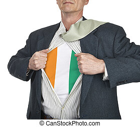 Businessman showing Ivory Coast flag superhero suit...