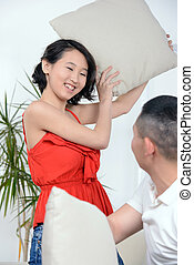 People At Home - Portrait of young Asian couple sitting on...