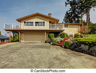 House exterior. View from drive way - House with deck and...