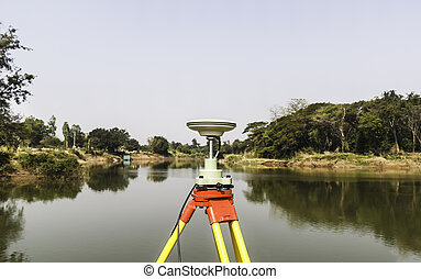 GPS surveying working near the river