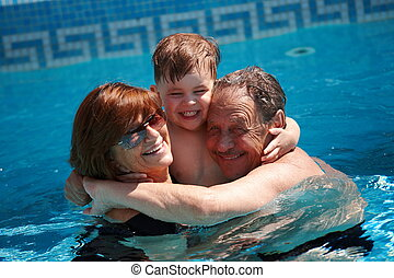 Grandparents and grandchild - Happy family: grandparents...
