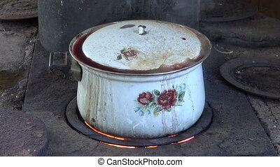 old pot boiling  in kitchen
